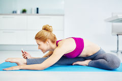 Smiling Young Woman Stretching and Listening to Music stock images