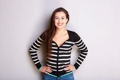 Smiling young woman in striped sweater. Portrait of smiling young woman in striped sweater Stock Image