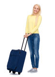 Smiling young woman with suitcase Royalty Free Stock Photo