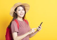Smiling young woman in summer hat and using smart phone stock photos