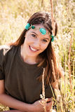 Smiling young woman in summer meadow Stock Images