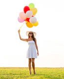 Smiling young woman in sunglasses with balloons Stock Photos