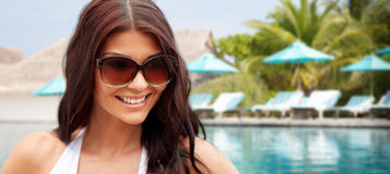 Smiling young woman with sunglasses on beach Royalty Free Stock Photography