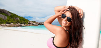 Smiling young woman with surfboard on summer beach Royalty Free Stock Photos