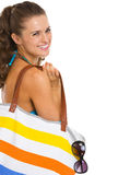 Smiling young woman in swimsuit with beach bag Stock Images