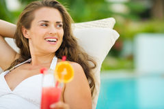 Smiling young woman in swimsuit with cocktail Royalty Free Stock Photos