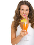 Smiling young woman in swimsuit drinking cocktail Stock Image