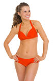 Smiling young woman in swimsuit looking on copy space Stock Image
