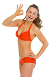 Smiling young woman in swimsuit showing ok gesture Royalty Free Stock Photography