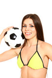 Smiling young woman with swimsuit and a soccer ball on a white b Stock Photography