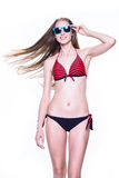 Smiling young woman in swimsuit and sunglasses Stock Image