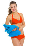 Smiling young woman in swimsuit with towel Stock Image