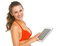 Smiling young woman in swimsuit using tablet pc Stock Photography