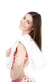 Smiling young woman in swimsuit with white towel, isolated Royalty Free Stock Photo