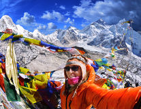 Smiling young woman takes a selfie  on mountain peak  Kala Patth Stock Image