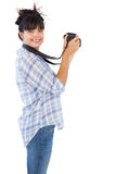 Smiling young woman taking picture with her camera Royalty Free Stock Image