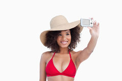 Smiling young woman taking a picture of herself Stock Photos