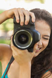 Smiling young woman taking a picture Royalty Free Stock Photo
