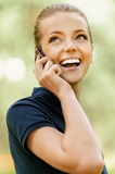 Smiling young woman talking on cell Stock Photo