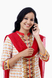 Smiling young woman talking on cell phone Royalty Free Stock Image