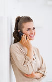 Smiling young woman talking cell phone Royalty Free Stock Image