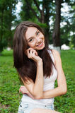Smiling young woman talking mobile outdoor Stock Photography