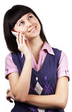 Smiling young woman talking on mobile phone. On a white background royalty free stock photo