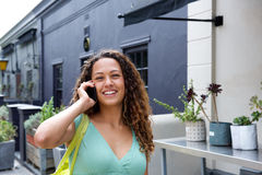Smiling young woman talking on mobile phone Stock Photos