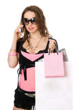 Smiling young woman talking on the phone. After shopping Royalty Free Stock Photography