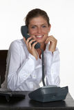 Smiling Young Woman Talking on Phone Royalty Free Stock Images