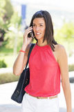 Smiling young woman talking by phone. Royalty Free Stock Photo