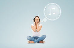 Smiling young woman or teen girl in headphones Stock Image