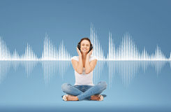 Smiling young woman or teen girl in headphones Royalty Free Stock Photos