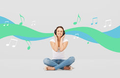 Smiling young woman or teen girl in headphones Stock Photos