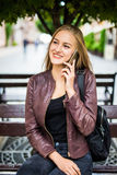 Smiling young woman or teenage girl calling on smartphone on city street Royalty Free Stock Photography