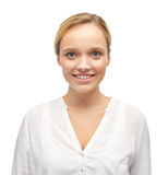 Smiling young woman or teenage girl in shirt Stock Image