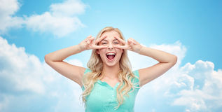 Smiling young woman or teenage girl showing peace Stock Photos