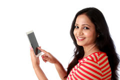 Smiling young woman texting against white royalty free stock images