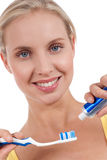 Smiling young woman with toothbrush Stock Photos