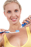 Smiling young woman with toothbrush. Isolated on white Stock Image