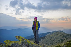 Smiling young woman   on  the  top of   mount Great Sivulja Stock Photo