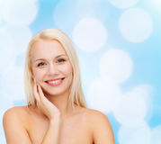 Smiling young woman touching her face skin Royalty Free Stock Photo