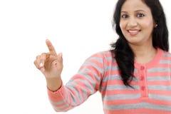 Smiling young woman touching imaginary screen Stock Photos