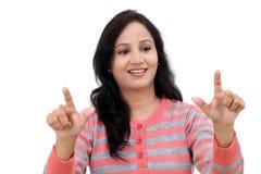 Smiling young woman touching imaginary screen Stock Photo