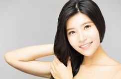 Smiling young Woman touching  Long and Healthy Black  Hair Royalty Free Stock Images