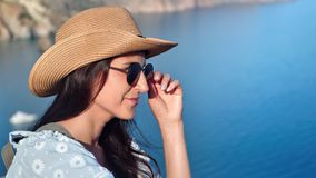 Smiling young woman tourist relaxing having positive emotion at blue clear sea background. Medium close-up. Happy face of beautiful travel female in sunglasses stock video footage