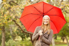 Smiling young woman under umbrella Royalty Free Stock Images