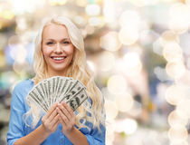 Smiling young woman with us dollar money Royalty Free Stock Photos