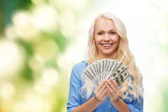 Smiling young woman with us dollar money Stock Images
