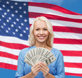 Smiling young woman with us dollar money Royalty Free Stock Image